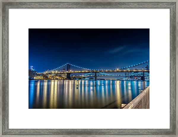 Manhattan Bridge And Light Reflections In East River. Framed Print