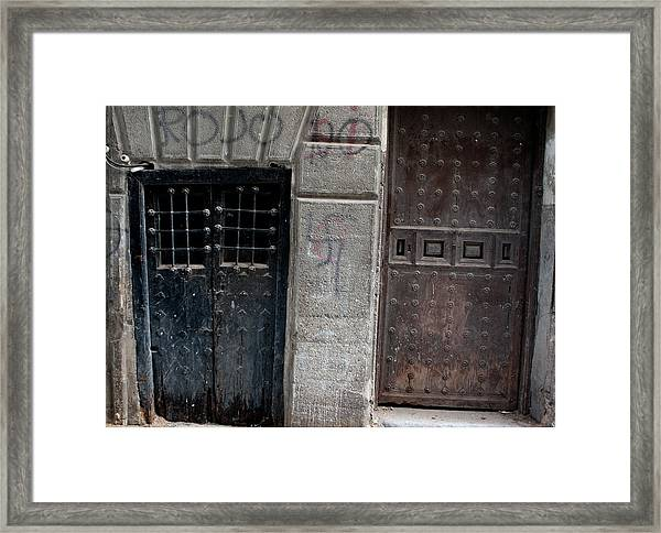 Framed Print featuring the photograph Medieval Doors Evil Graffiti by Lorraine Devon Wilke