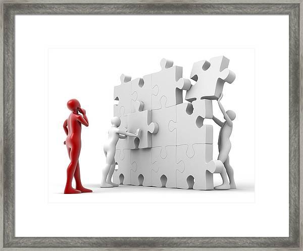 Men Putting Puzzle Pieces Together Framed Print