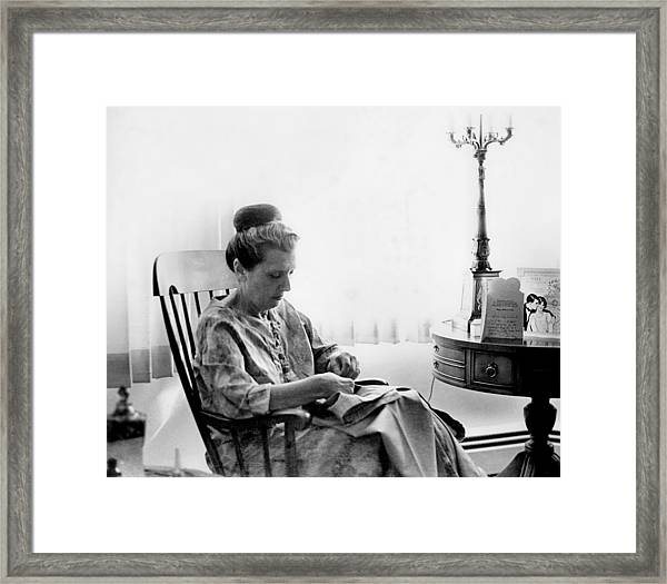 Mending More Than Clothes Framed Print