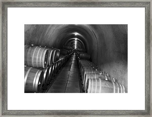 Napa Wine Barrels In Cellar Framed Print