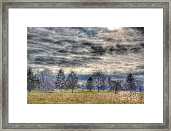Ominous Skies At The Park Framed Print