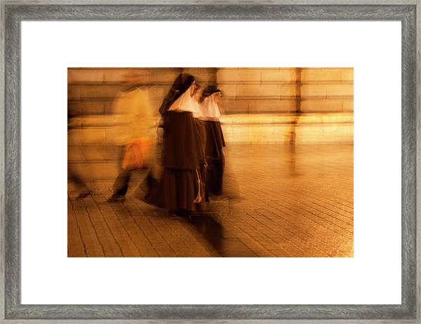 Framed Print featuring the photograph Piety In Motion by Lorraine Devon Wilke