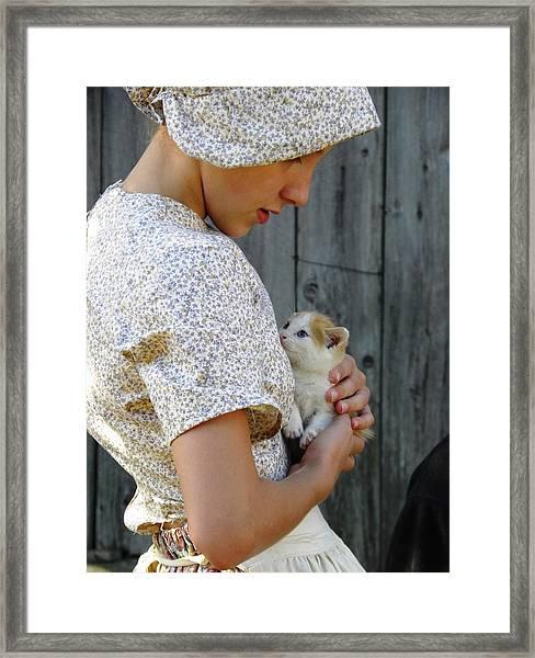 Pioneer Girl With Kitten Framed Print