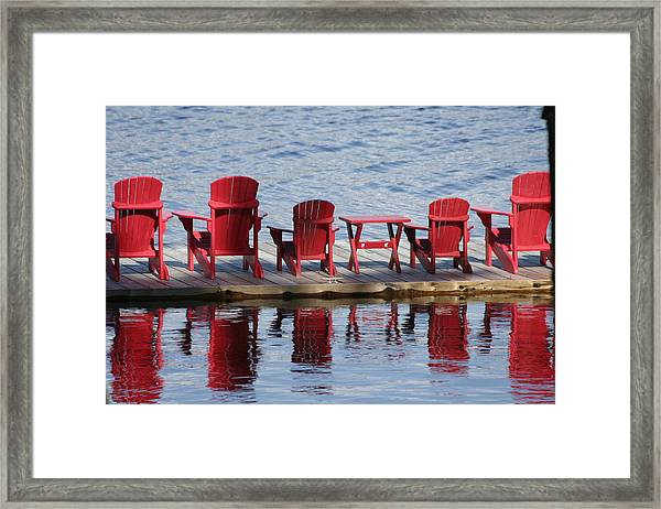 Red Muskoka Chairs Framed Print by Carolyn Reinhart