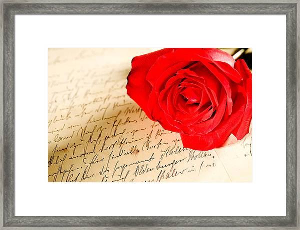 Red Rose Over A Hand Written Letter Framed Print