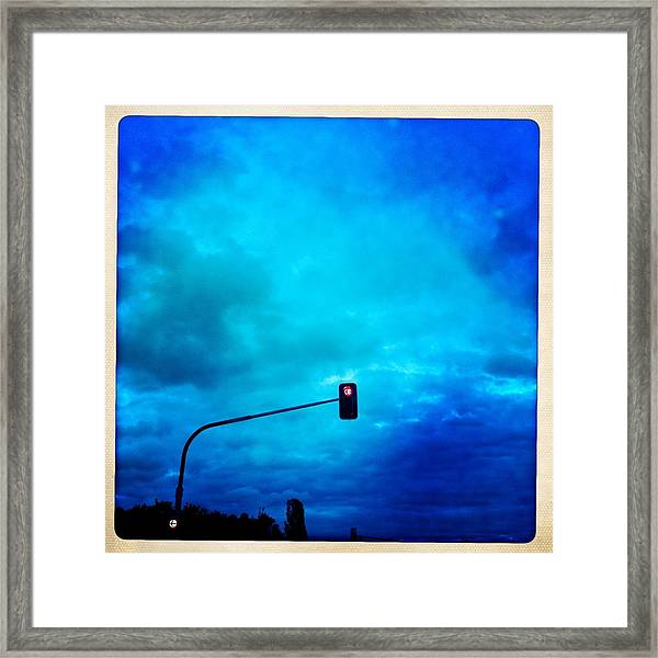 Red Traffic Light And Cloudy Blue Sky Framed Print