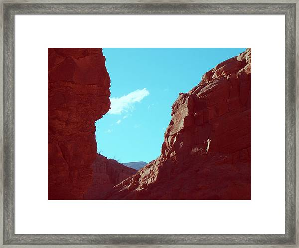 Rocks And Sky Framed Print