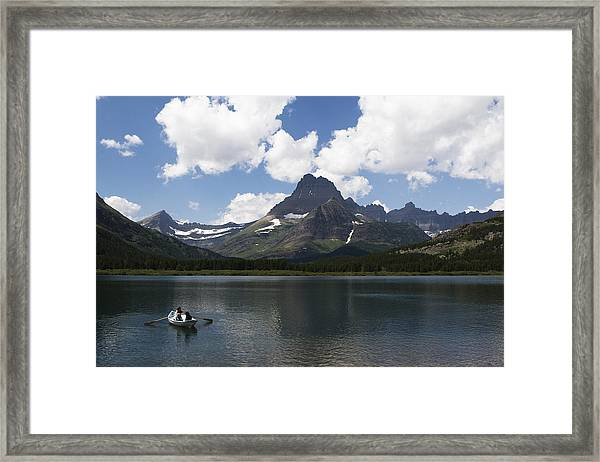 Framed Print featuring the photograph Rowboat At Many Glacier by Lorraine Devon Wilke