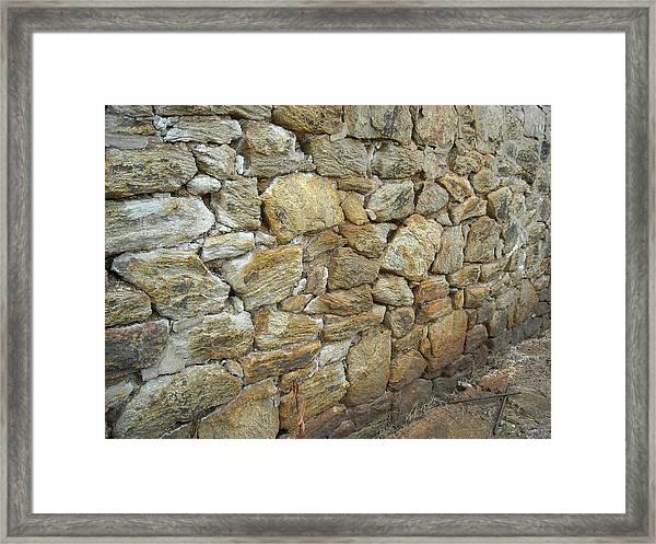 Rusty Stone Wall Framed Print