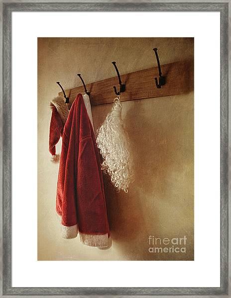 Santa Costume Hanging On Coat Rack Framed Print
