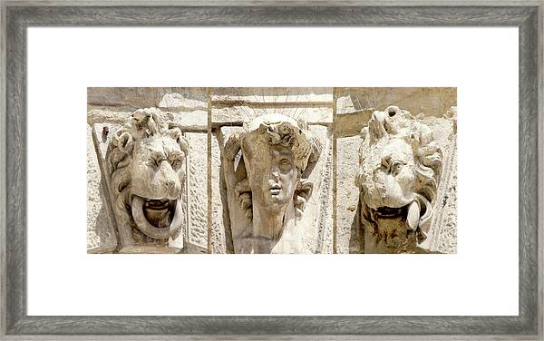 Sculptured Heads Framed Print