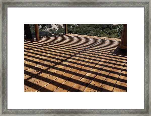 Shadows And Planks Framed Print