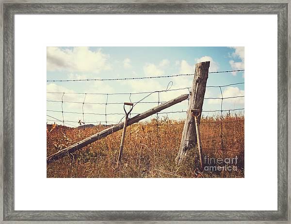 Shovels Leaning Against The Fence Framed Print