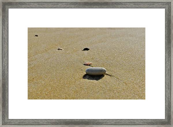 Stones In The Sand Framed Print