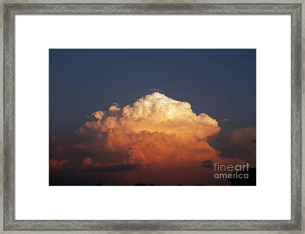 Storm Clouds At Sunset Framed Print