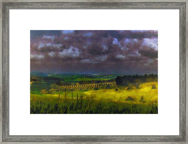Storm Clouds Over Meadow Framed Print