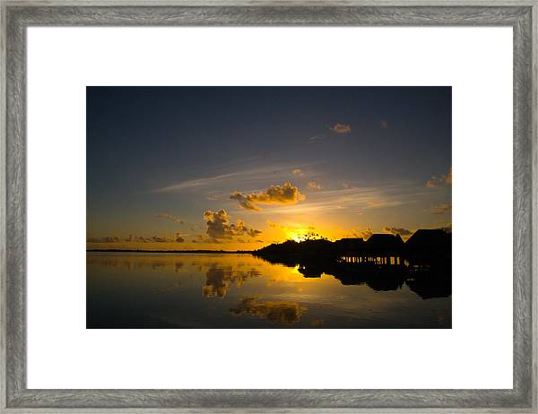 Sunrise In Bora Bora With Overwater Bungalows Framed Print by Benjamin Clark