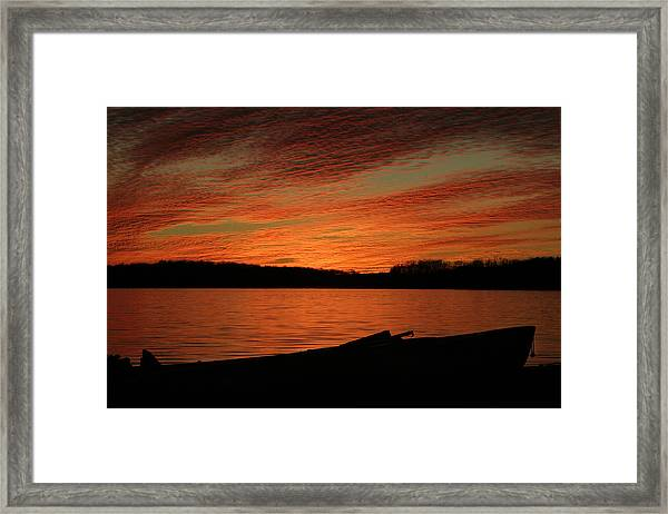 Sunset And Kayak Framed Print
