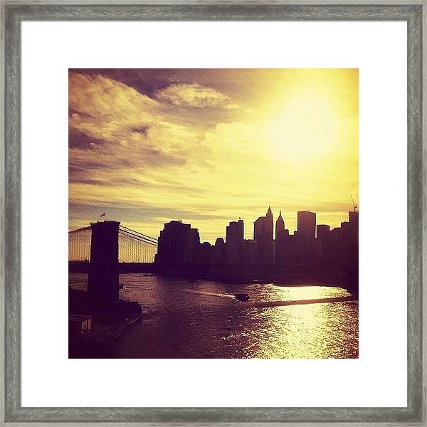 Sunset Over The New York City Skyline And The Brooklyn Bridge Framed Print