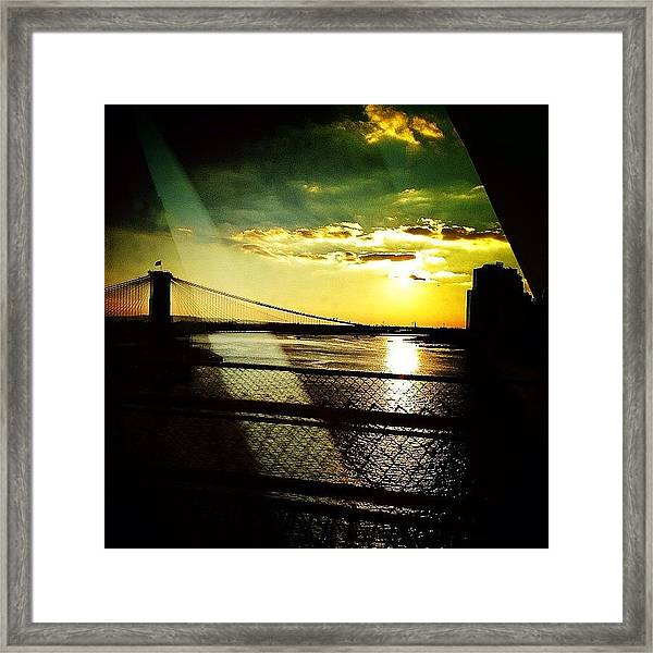 The Brooklyn Bridge At Dusk Framed Print
