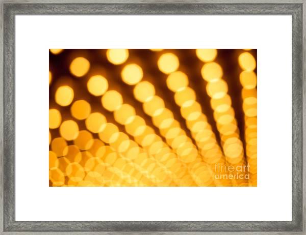 Theater Lights In Rows Defocused Framed Print by Paul Velgos