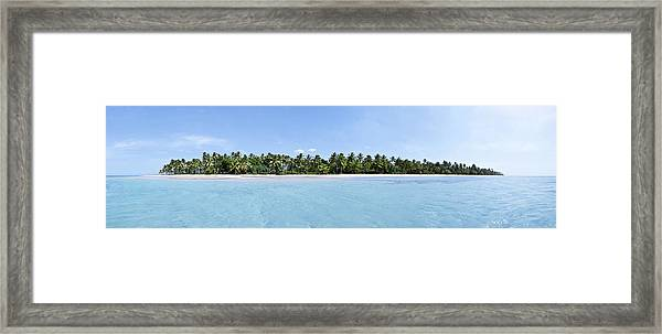 Tropical Island Floating Over Turquoise Water Framed Print by Sebastien Coursol