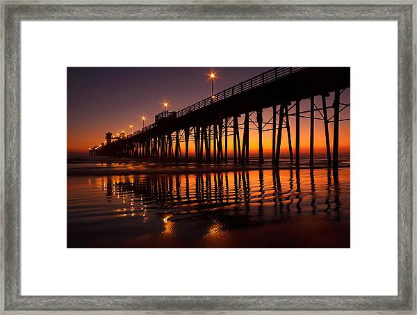 Twilight Night Lights Framed Print by Donna Pagakis