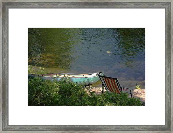 Typical Canoe And Chair Framed Print by Carolyn Reinhart