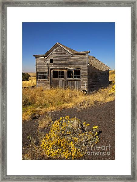 Under The Weight Of It All Framed Print