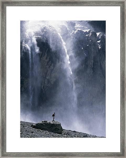 Walker Beneath Waterfall In The Cirque Framed Print
