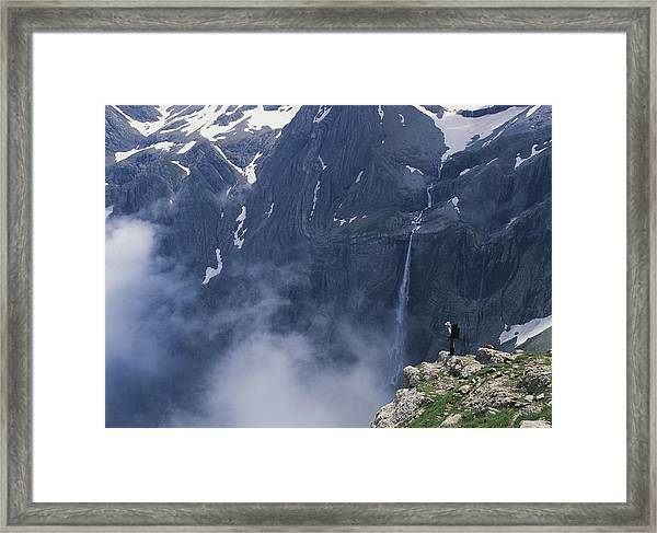 Walker Looking Over Waterfall At Cirque Framed Print