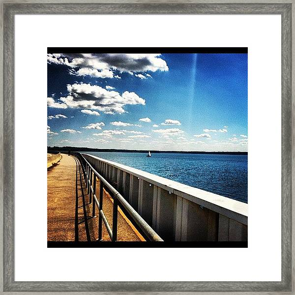 Walking The Dam  Framed Print
