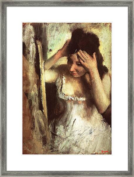 Woman Combing Her Hair Before A Mirror Framed Print