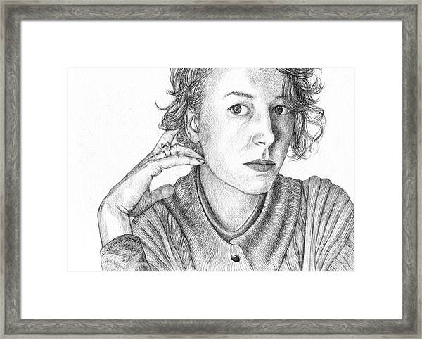 Woman In Sweater Framed Print