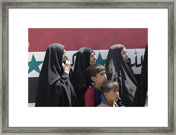 Women And Children Wait In Front Of An Framed Print by Everett