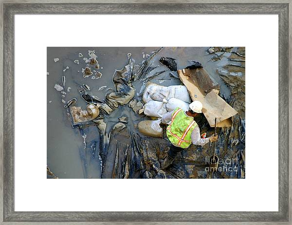 Working The Mud Framed Print