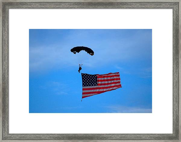 A Skydiver With An American Flag  Framed Print