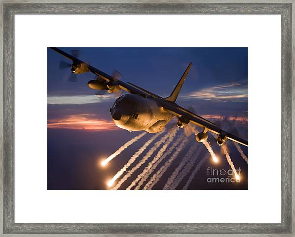 A C-130 Hercules Releases Flares Framed Print