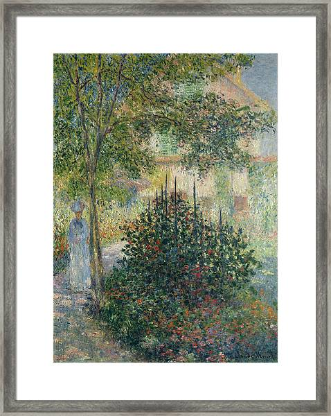 Camille Monet In The Garden At Argenteuil Framed Print