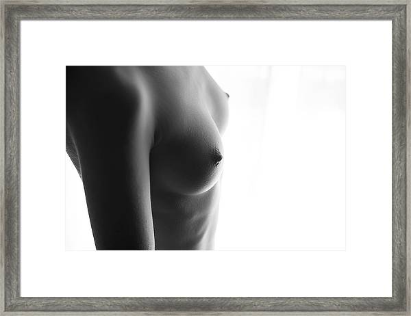 Girls Torso In Front Of Window Framed Print