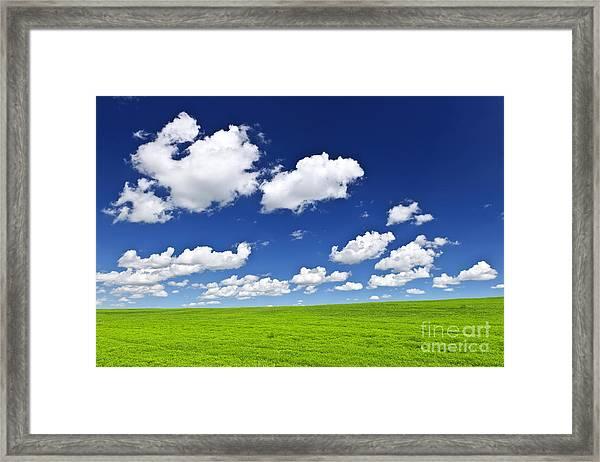 Green Rolling Hills Under Blue Sky Framed Print