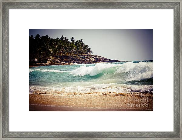 Framed Print featuring the photograph Ocean Wave With Rocky Cliffs And Palm Trees by Raimond Klavins