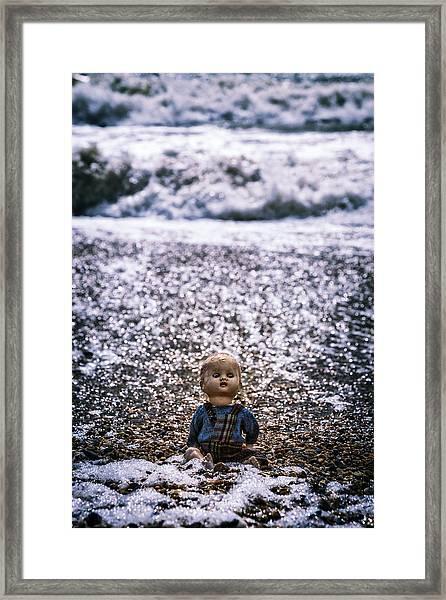 Old Doll On The Beach Framed Print