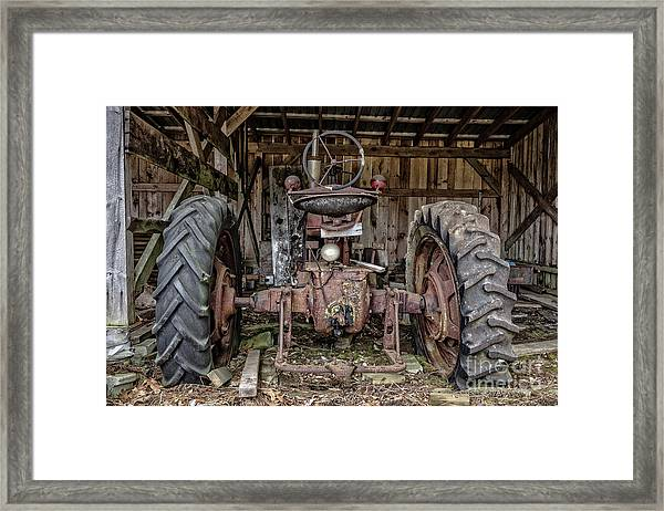 Old Tractor In The Barn Framed Print