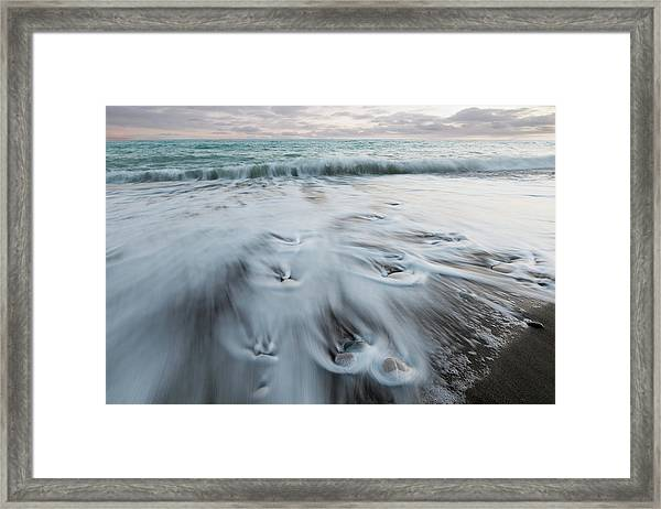 Pebbles In The Beach And Flowing Sea Water Framed Print