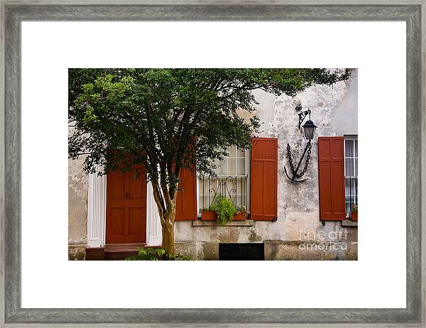 Framed Print featuring the photograph Red Shutters by Susan Cole Kelly