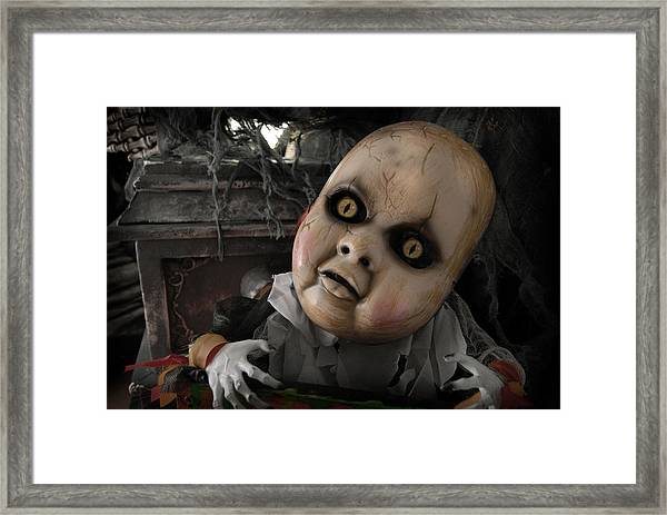 Scary Doll Framed Print