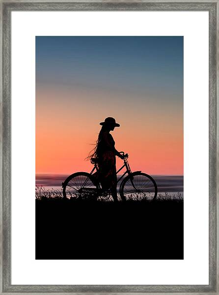 Silhouette Of Girl And Bike At Sunset Near The Sea. Framed Print