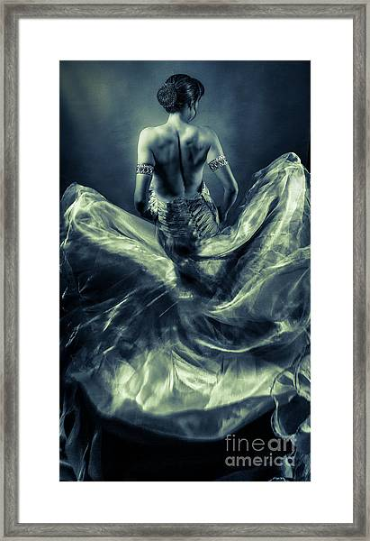 Woman In A Billowing Blue Gown Framed Print